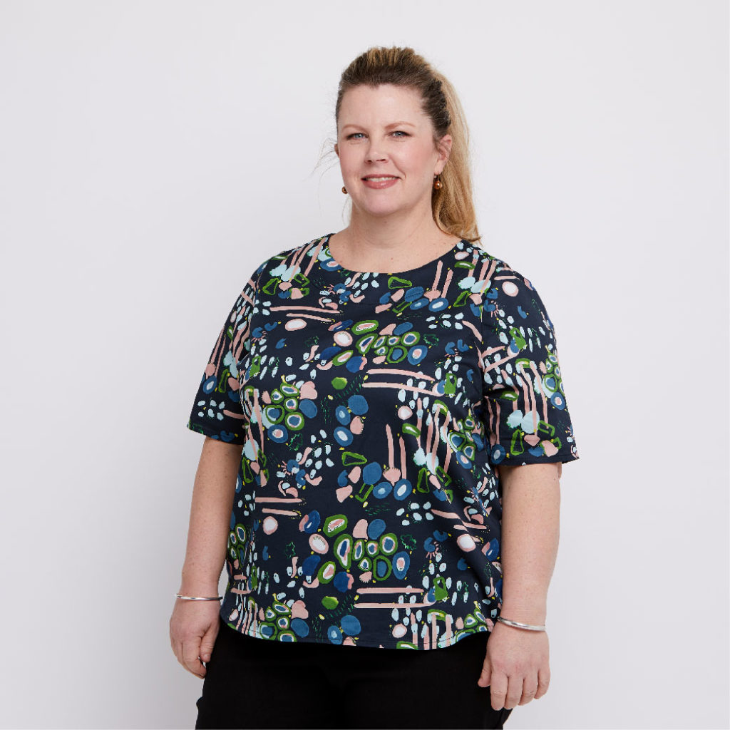 Size 18 model wears cotton sateen plus size blouse printed with lines and dots in a hand painted style