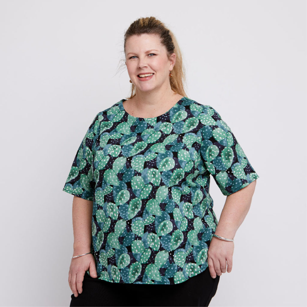 Size 18 models wearing plus size women's cotton blouse with a stylised green prickly pear print