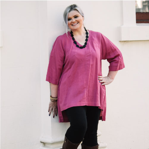 Size 16 model wearing plus size handmade hot pink linen top